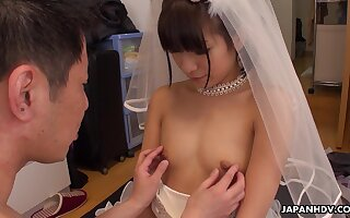 Japanese bride Ruri Narumiya bends over being fucked doggy style