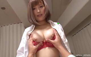 Hot Japanese doctor Hamasaki Mao spreads her feet to ride a dick
