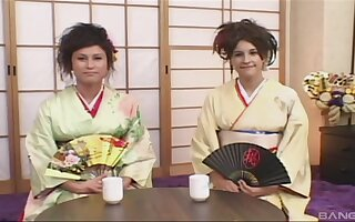Cute brunette wears her sexy kimono to seduce and please her lover