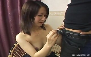 Shy Asian chick undressed and takes a long cock in her mouth