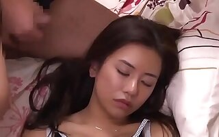 Sweet Asian girl lets a friend massage her cunt with a cock