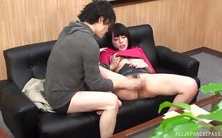 Cute Japanese sits clothed while the man handles her bush