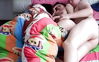 Chinese husband cheating on wife while she is sleeping.