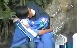 Elegant Jilbab Girl kissing her lover in the homeland